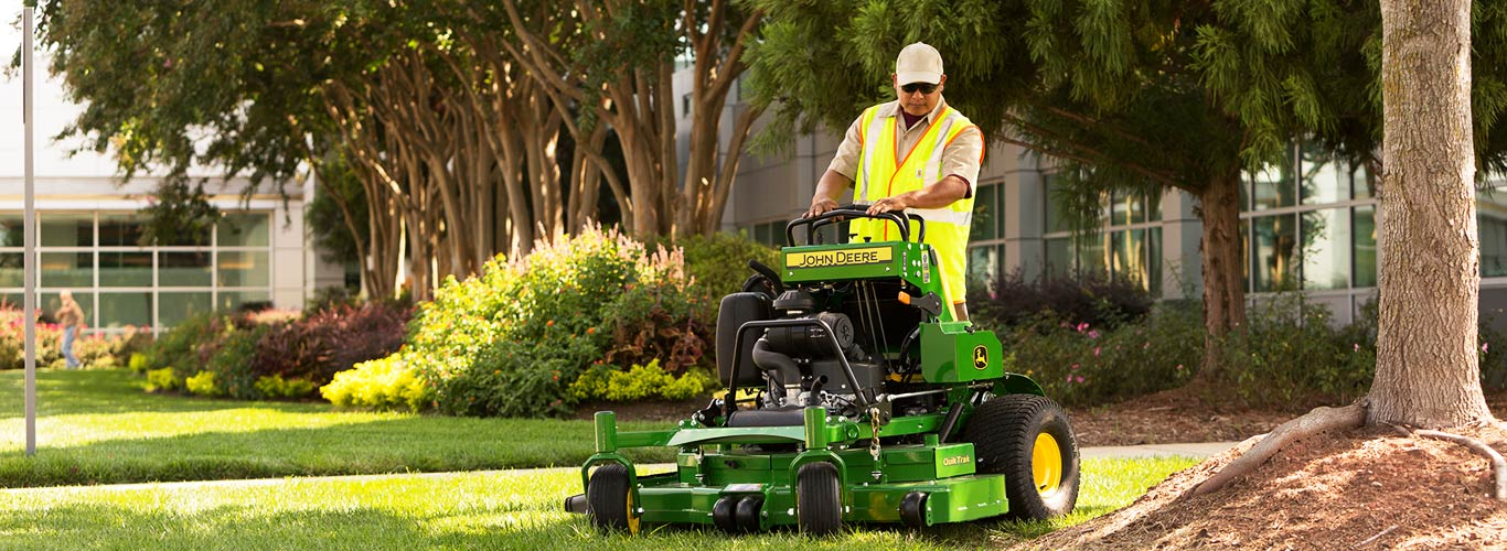 Image of QuikTrak Stand-On Mower on property