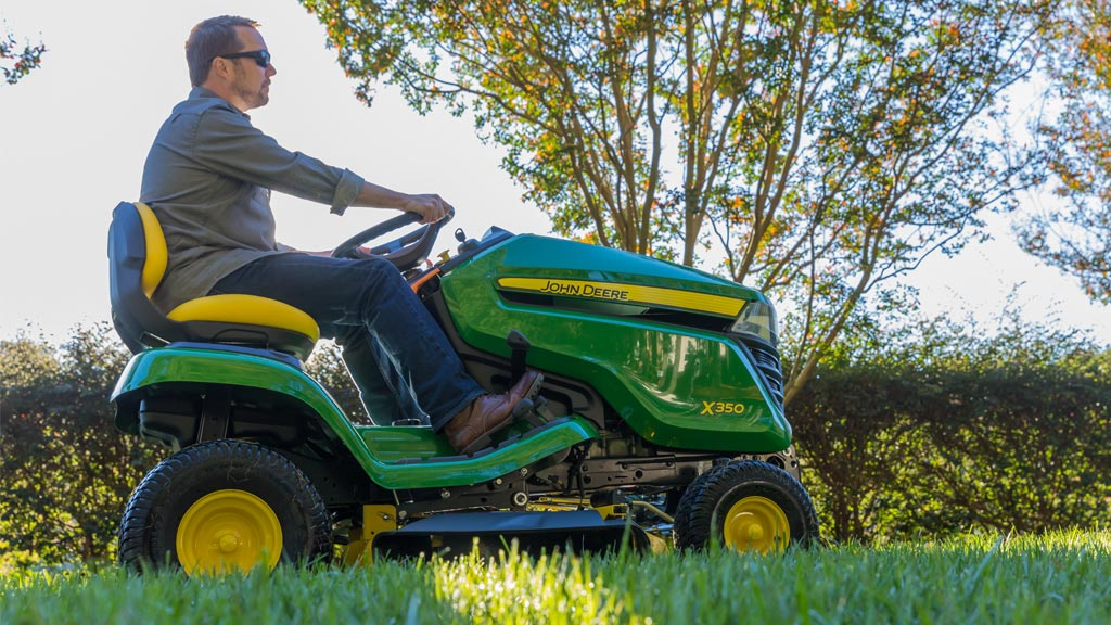Man mowing grass with an X350 lawn tractor