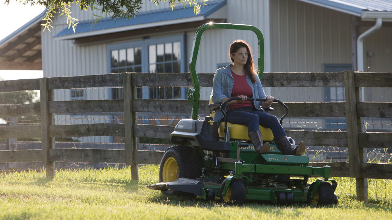field image of women on a Z700-Series ztrak mower
