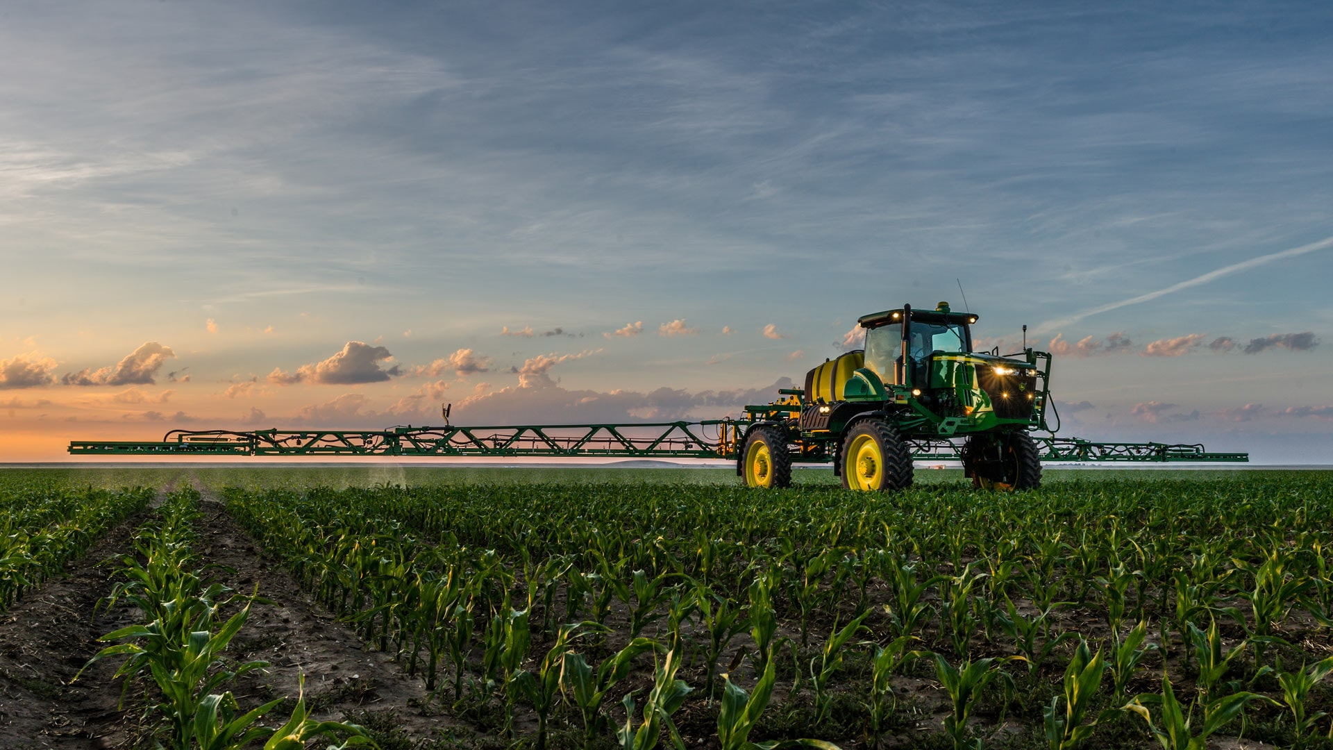 variable rate application photo tractor spraying in field