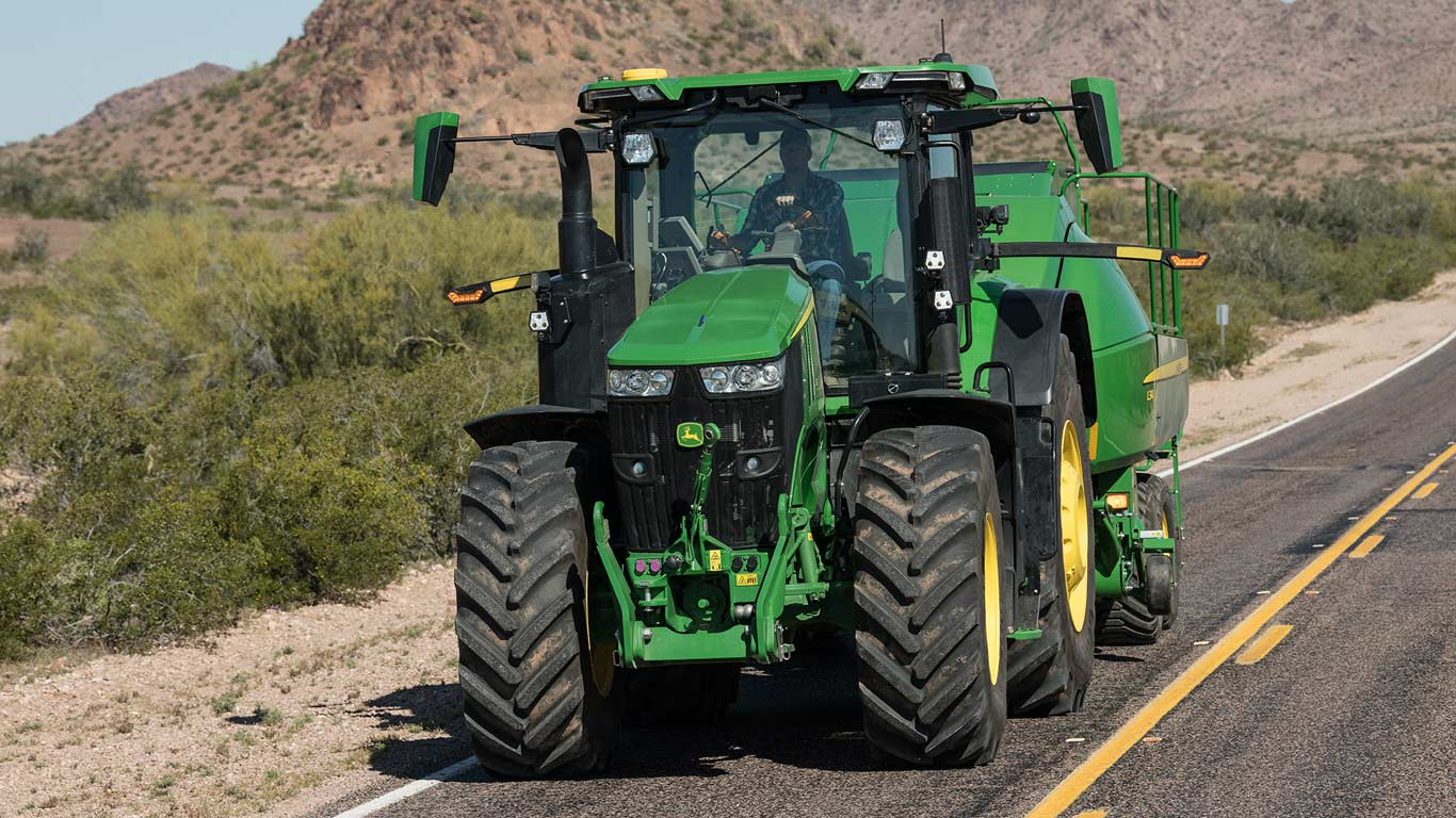 tractor driving on road