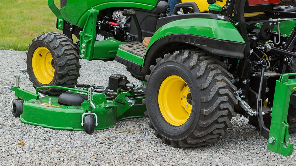close up of 1025R rolling over mower deck hook up