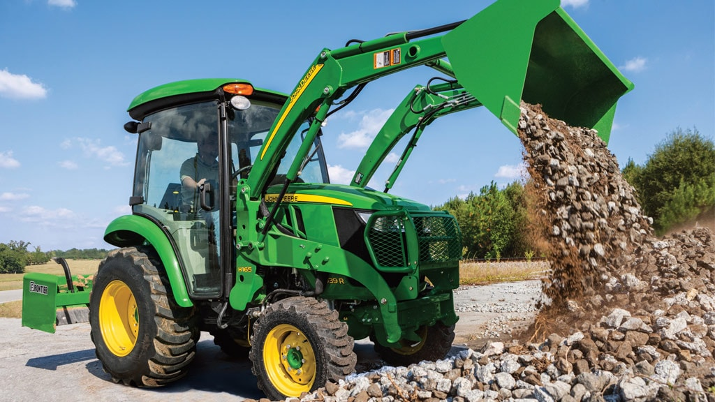 image of 3039r compact utility tractor moving gravel with front loader