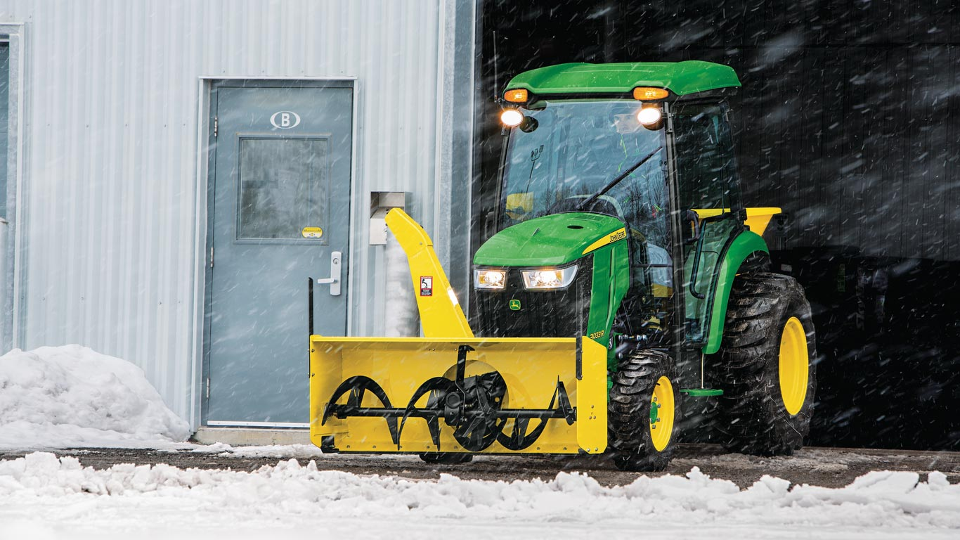 image of 3033r compact utility tractor with snow blower attachment