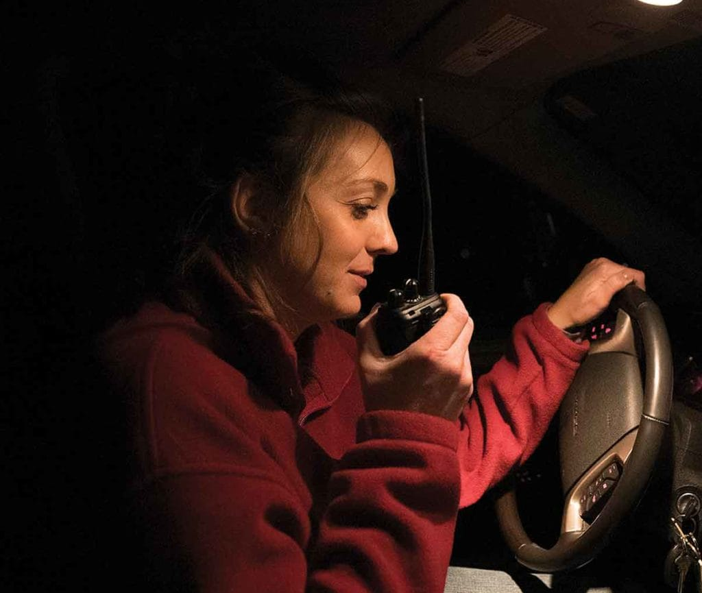 Woman talking in car with device