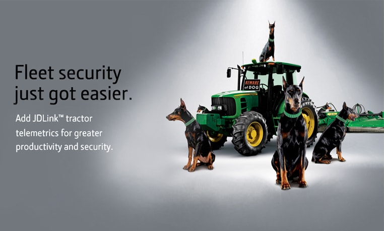 John Deere Tractor surrounded by guard dogs