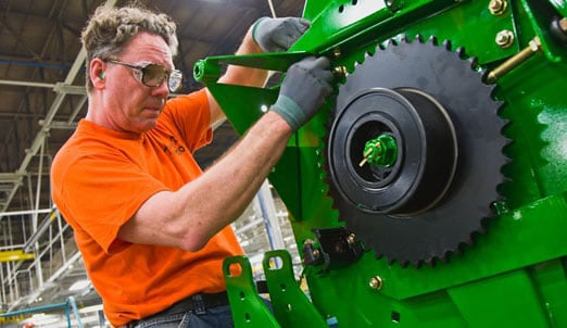 John Deere employee working at a factory