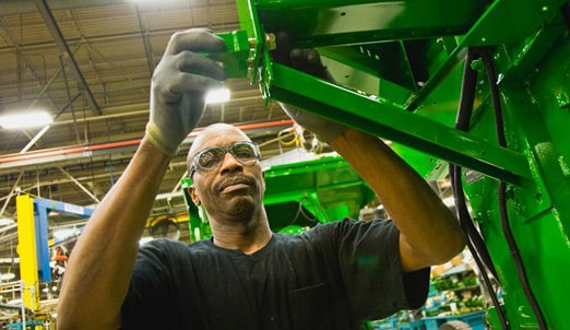 John Deere employee working in a factory
