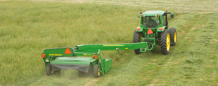 Mower conditioner being pulled by tractor