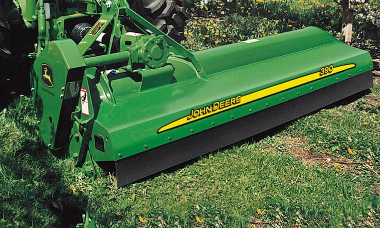 Closeup of a John Deere Flail Mower working in a grassy area