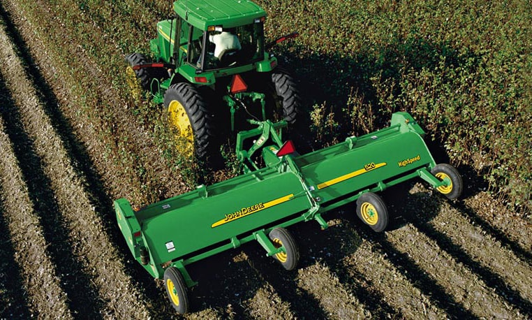 Overhead view of a John Deere Tractor with attached Flail Shredder working in a field
