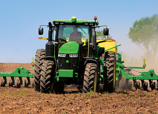 A 7230R Tractor working hard to prepare a field