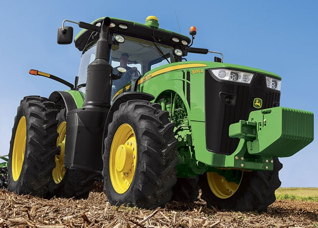 Close up front view of the 8295R Tractor in a field