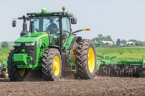 8270R Tractor with tillage equipment plowing a field