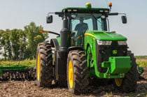 8320R Tractor with tillage equipment plowing a field