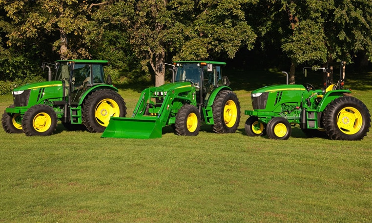 Three of John Deere's Agricultural Equipment offerings in a line