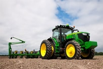6R Series Tractor with planter attachment in a field