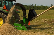 WC11 Series Wood Chipper turns a tree limb into a pile of mulch
