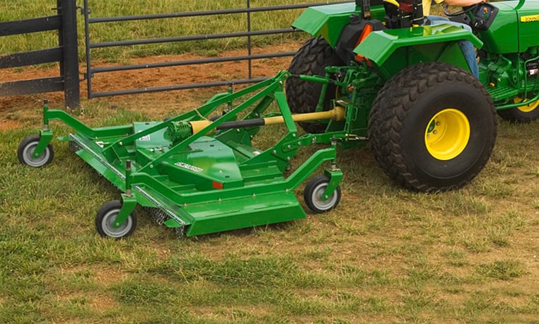 A Grooming Mower is used behind a tractor