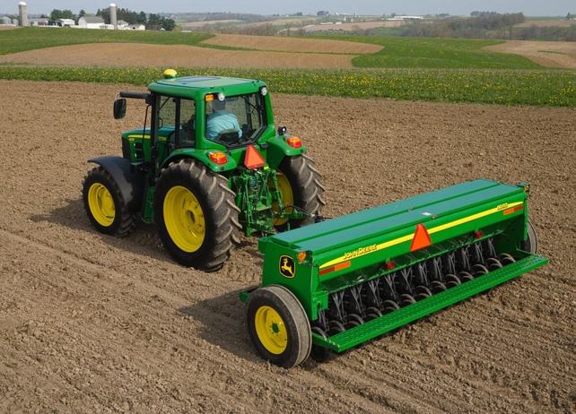 Overhead view of John Deere tractor with BD11 End-Wheel Grain Drill working in a field
