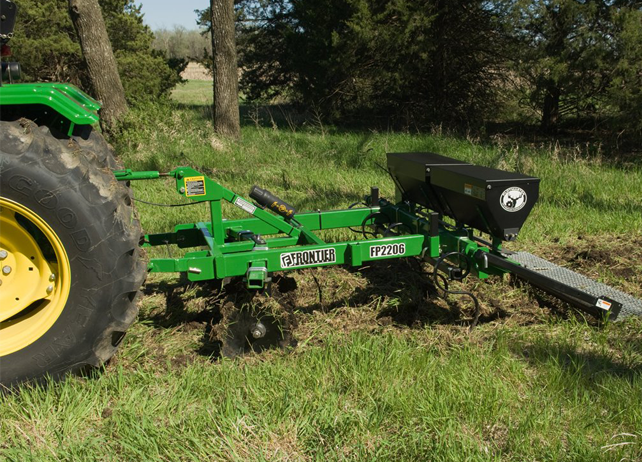 FP22 Food-Plot Seeder working in a grassy field near a group of trees