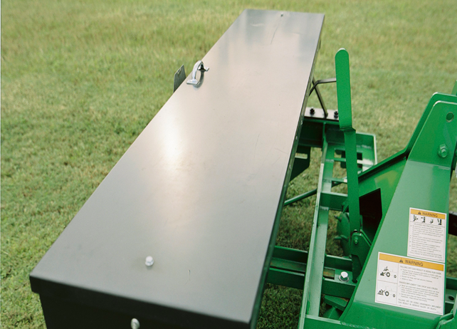 Closeup of a TR20 Overseeder on a grassy lawn