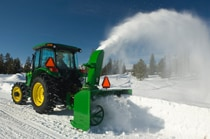 John Deere tractor using a SB13 3-Point Snowblower to clear snow