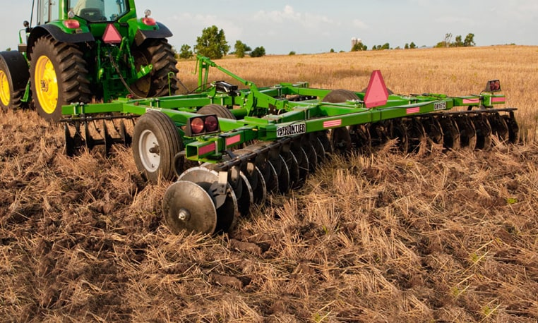 Disk Harrows tilling a field