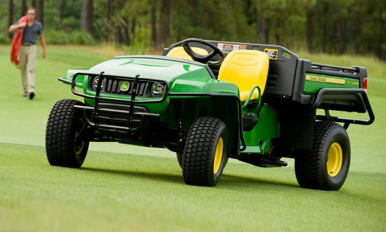 A Gator Turf Vehicle sits alone on the golf course