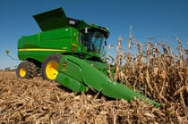 S680 Combine harvesting corn with blue sky in the background