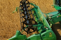 620 Flex Cutting Platform on a John Deere Combine harvesting in a field