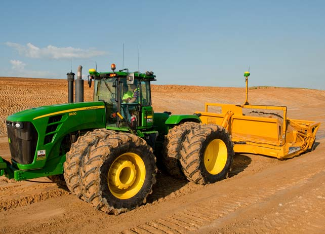 Tractor uses iGrade automated water management system to level dirt