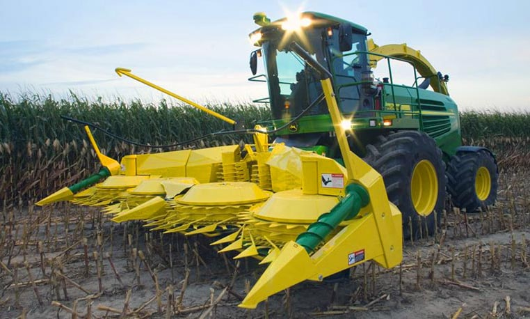 A farmer uses a John Deere Rotary Harvesting Unit for dense crops