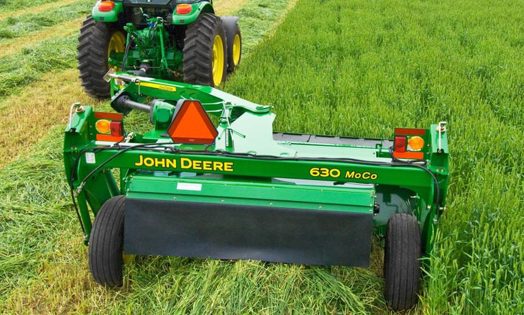 A John Deere tractor pulls a 630 Mower-Conditioner