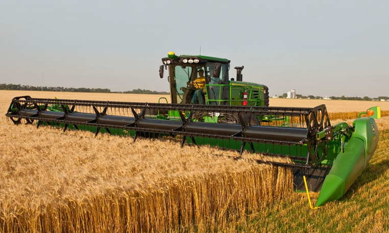 Farmer uses a 635D Draper to harvest