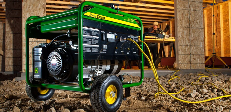 A John Deere Portable Generator sits outside a home being built