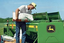 Farmer loads a drill box with seed