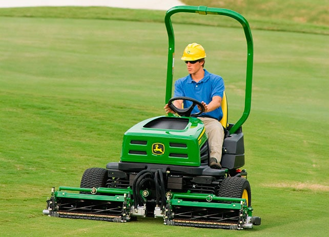 A member of the grounds crew operates a 2653B Trim and Surrounds Mower