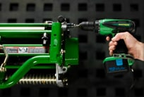 Closeup of a cordless drill adjusting the Cutting Units on a PrecisionCut mower