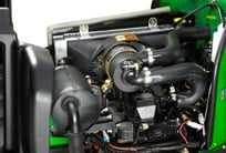 Closeup of the engine compartment under the hood of the PrecisionCut mower