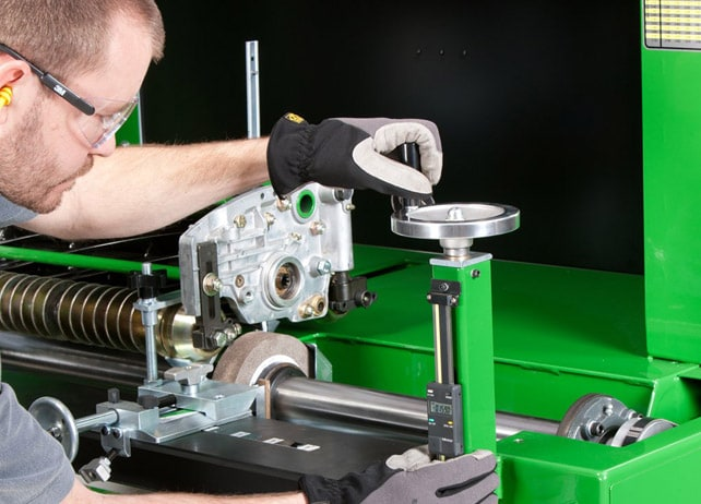 Close up of a technician using an RG5500 Semi-Automatic Spin and Relief Reel Grinder