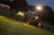 Tractor in a dark environment shows off its premium lighting options.