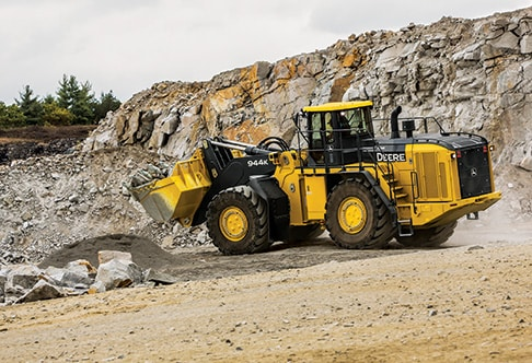 Left hand view of the 944K Hybrid Wheel Loader at a quarry