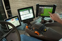 Image of interior of tractor cab with SeedStar Mobile display