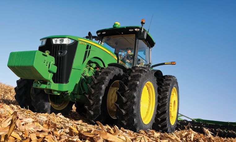 Photo of a tractor in field using AutoTrac™ Guidance