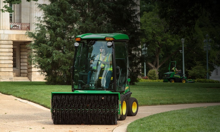 Image of front mower with brush attachment
