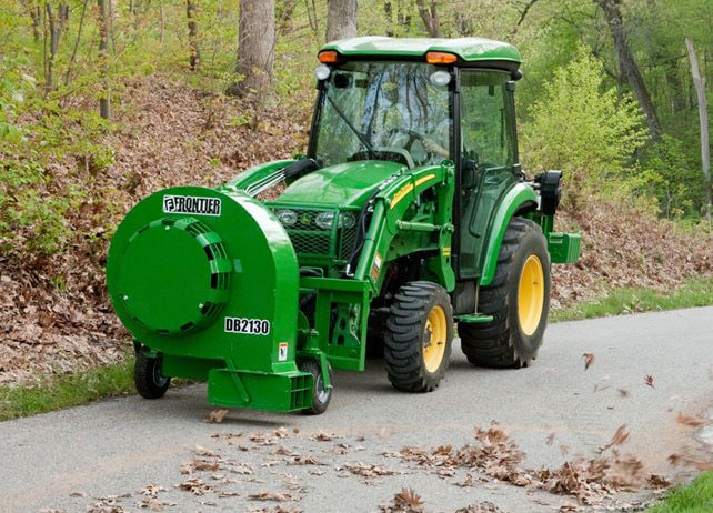 The BL21 Series Loader-Mount Hydraulic Debris Blower removes leaves from a path