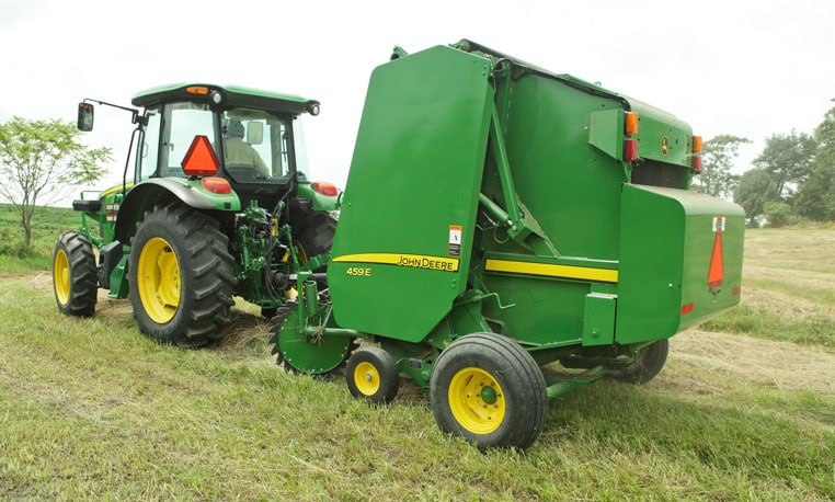 Image of a 459E Baler in a field.