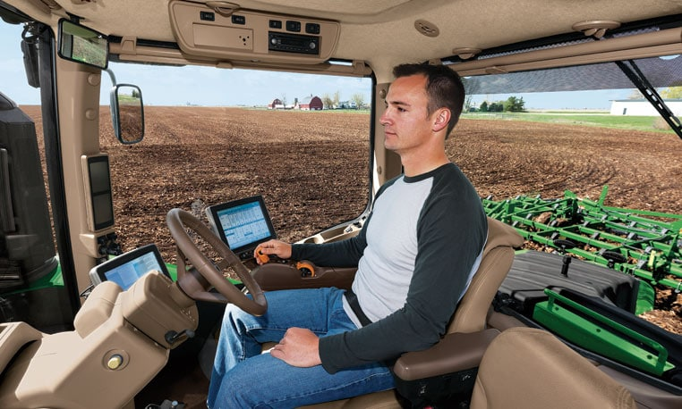 Man in cab of 9RX tractor